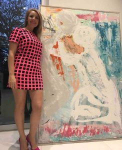 Artist Sarah Jane with Reaching Out - A Large Modern Colourful Painting of a couple supporting one another