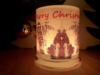 Christmas Tree Candle At Night front view
