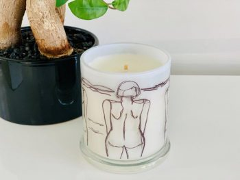 Designer Candles By Sarah Jane - Black and White Artwork of a woman at the beach called Linear III