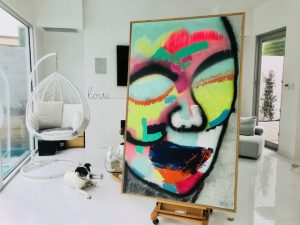Sarah Jane Painting of a colourful face - Hidden Truth
