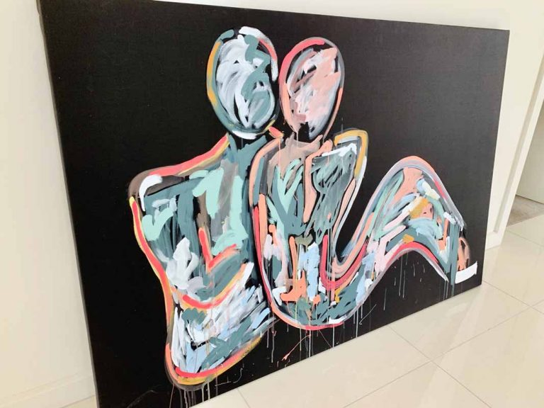 colourful black canvas painting of a couple sitting by sarah jane artist