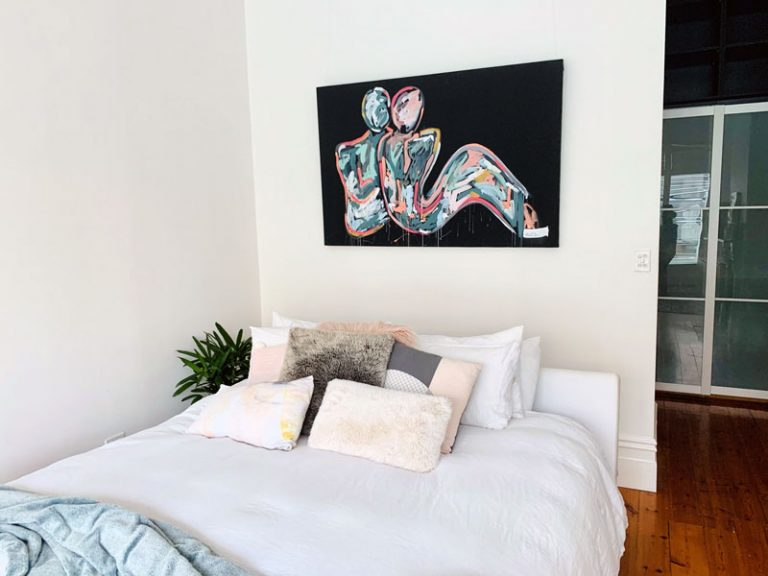 contemporary bedroom with black canvas art titled lovers crush i by australian artist sarah jane