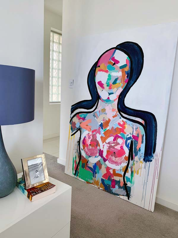 modern bedroom with large contemporary original painting titled love generation by sarah jane australian artist